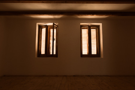 come in: Open the window and let the light come in. Selective focus, lens flare, toned image. Stock Photo