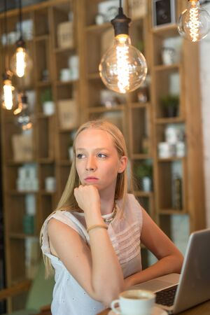 cropped shot: A cropped shot of a beautiful young woman working from cafe shop.