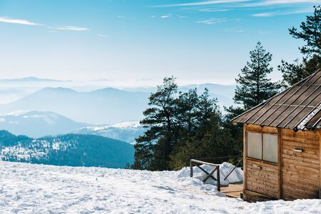 winter vacation: Wooden cottage on the top of the mountain with an awesome view.