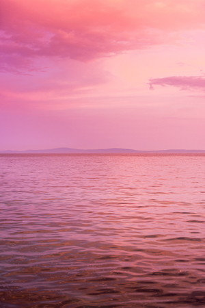 pink wallpaper: Purple sunset colors on the seaside. Stock Photo