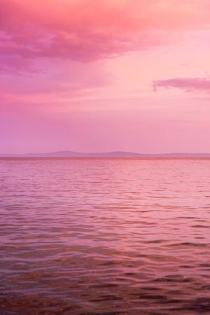 purple sunset: Purple sunset colors on the seaside. Stock Photo