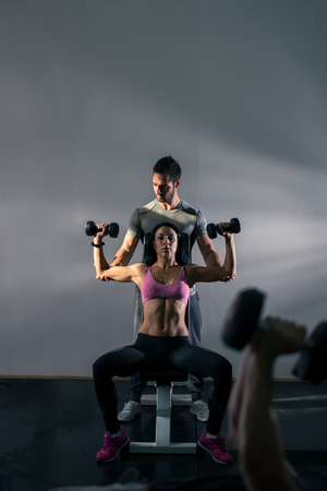 contrasty: Doing some exercises together. Dramatic light, deep shadows, toned images, contrasty image. Stock Photo
