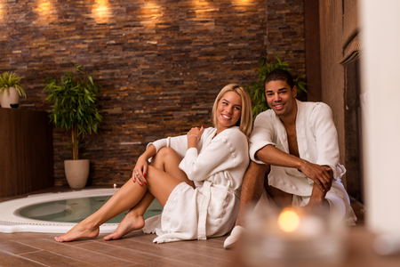 Shot of a couple posing together at the spa. High ISO, grainy image, selective focus.