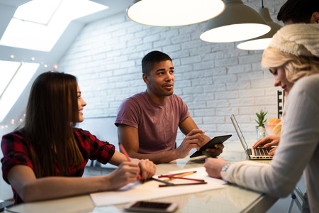 Shot of a group of young designers starting a small business. Selective focus. Stock Photo