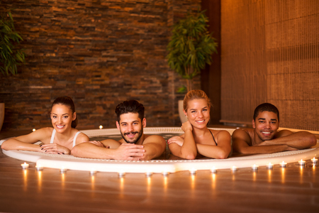 Shot of a friends having some great time at the spa.