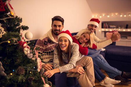 Shot of happy friends enjoying holidays. Selective focus, toned image,ambiental light. Stock Photo