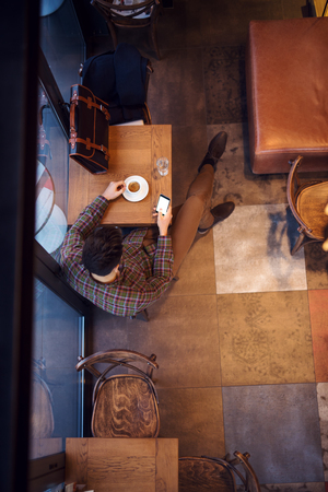 sip: High angle shot of a man taking a sip of coffee.