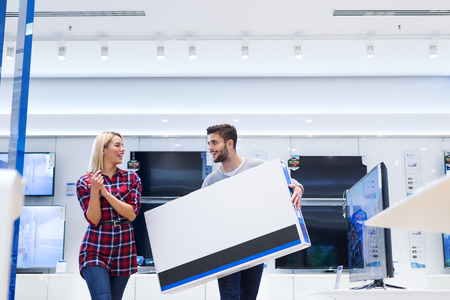 Shot of a happy couple shopping TV.