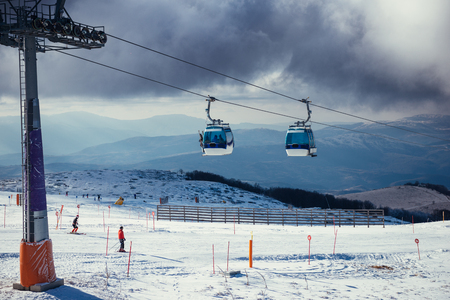 ski lift: Ski lift on a cloudy winter sky. Stock Photo
