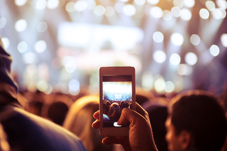capturing: Mobile photographer capturing favorite artist and stage.