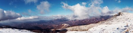 mountain peek: Panorama of a high mountain peak covered with snow. Stock Photo