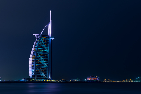 Luxurious hotel Burj Al Arab photographed by night.