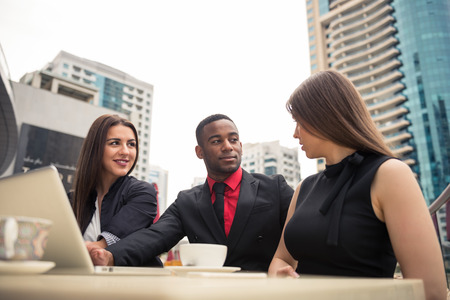 black professional: Business partners having an outdoors meeting.