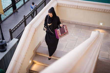 scarves: Beautiful muslim woman enjoying shopping time in the city. Stock Photo