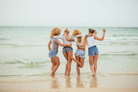ass fun: Pretty girls enjoying summer time on the beach. Stock Photo