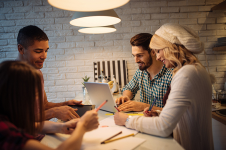business project: Group of friends working together from home. Stock Photo