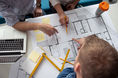 Architect working on a building plans.