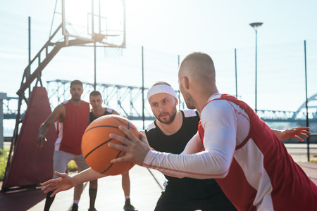 ouside: A young basketball player prepares to dribble a ball. Stock Photo