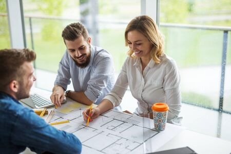 Team of architects planning a successful building project. Stock Photo