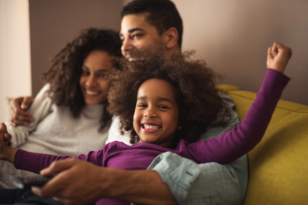 African american family spending time together at home. Standard-Bild