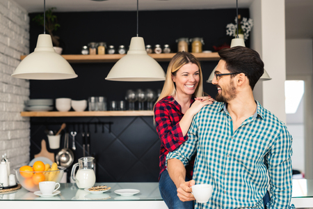 Shot of a couple drinking a morning coffee together.
