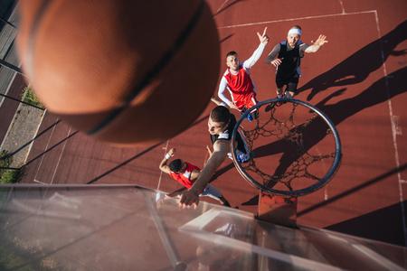 A young basketball player scoring a slam dunk.