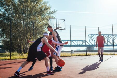 dribbling: A young basketball player dribbling a ball. Stock Photo