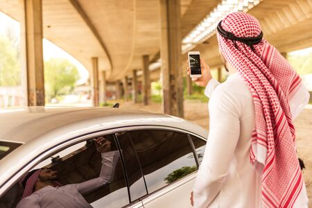 capturing: Man capturing on a mobile phone while traveling. Stock Photo