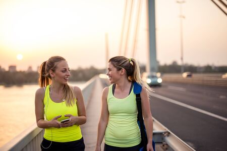 frienship: Two attractive female athletes talking together. Stock Photo