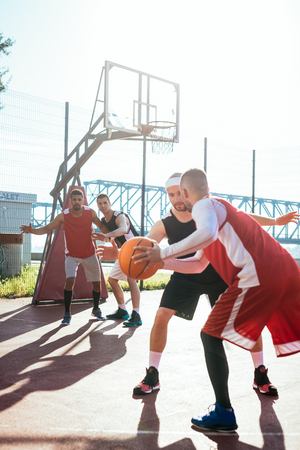 ouside: A young basketball player dribbling a ball. Stock Photo