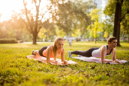 endurance: Two girls doing endurance exercises outdoors in the park.