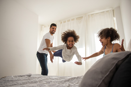 African american family having fun together at home.