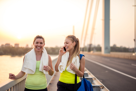frienship: Two friends training outdoors on the bridge. Stock Photo