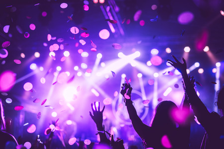 white party: Crowd raising their hands and enjoying great festival party. Stock Photo