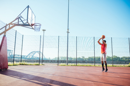 ouside: African american basketball player showing his skills. Stock Photo