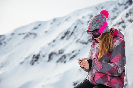 mountain peek: Girl texting outdoors on the mountain peek.