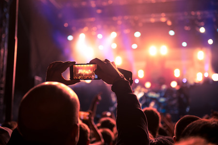 capturing: People capturing best memories on a mobile phone. Stock Photo
