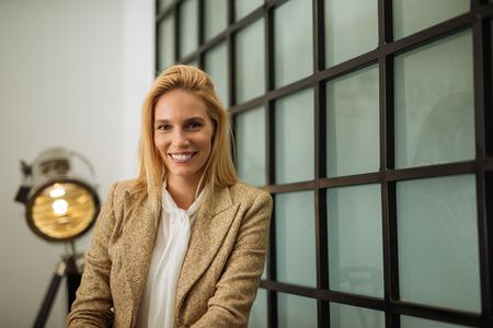 Beautiful blonde businesswoman posing in an office.