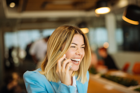 sucessful: Smiling attractive woman talking on a mobile phone. Stock Photo