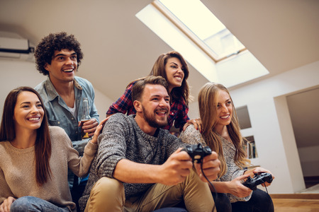 Group of friends playing video games together.