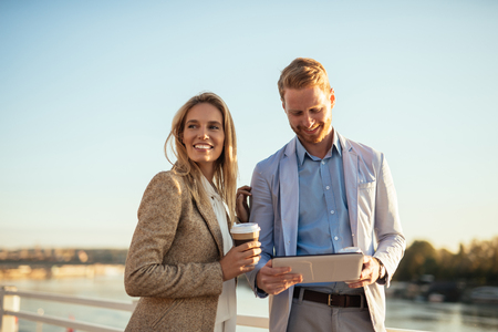 confident business woman: Beautiful couple enjoying city walk together outdoors.