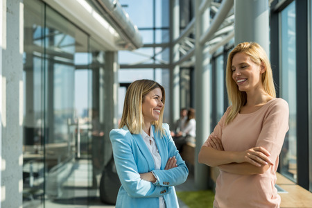 sucessful: Female colleagues chatting during the break at work.