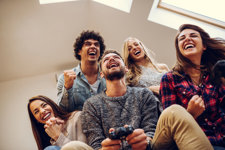 gamers: Group of friends playing video games together.