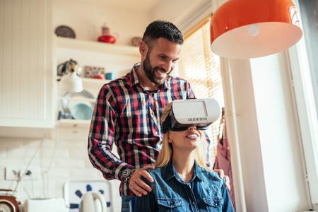 virtual world: Happy girl enjoying a virtual world on VR headset. Stock Photo