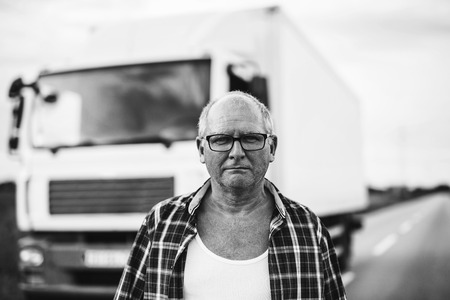 Black and white portrait of a senior truck driver.