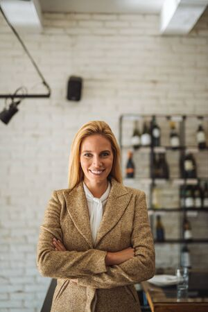 Portrait of attractive young businesswoman with crossed arms. Stock Photo