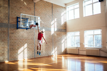 Handsome caucasian basketball player scoring a point.
