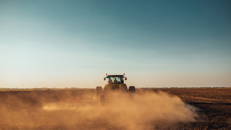 Tractor preparing land for sowing in spring.