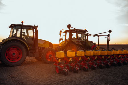 Preparing farmland with seed for the next year. Stock Photo