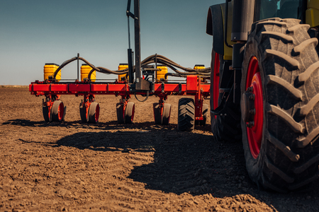 next year: Preparing farmland with seed for the next year. Stock Photo